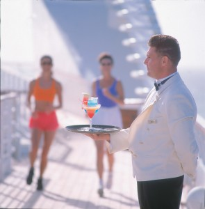 PSLSSM03 profile of white jacket server holds tray of cocktails joggers blurred in background